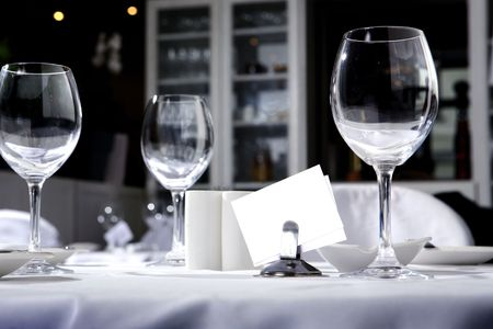 plate setting: glass goblets on the table Stock Photo