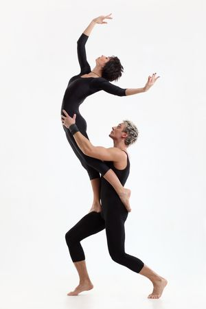 performers: two young modern acrobats posing on white Stock Photo