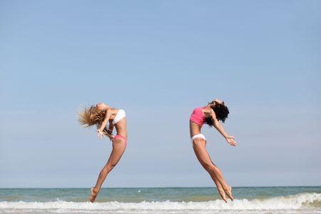 beautiful dancer posing on the sandy sea beach photo