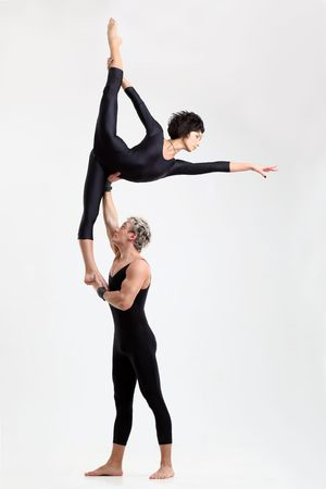 entertainer: two young modern acrobats posing on white Stock Photo