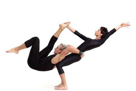 flexible: two young modern acrobats posing on white Stock Photo
