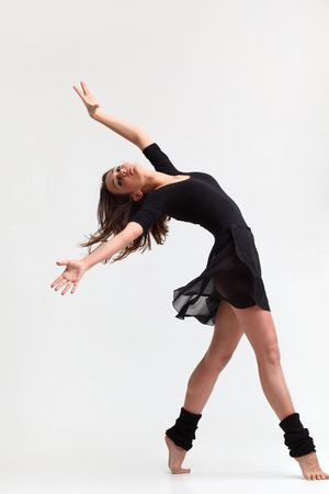 modern style dancer posing on studio background photo