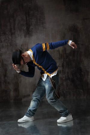 rap: modern style dancer posing on studio background