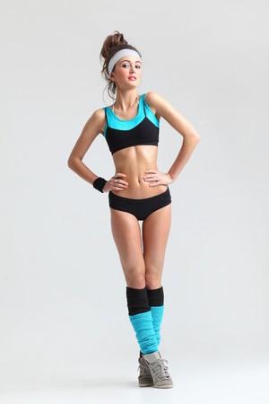 feminity: modern style dancer posing on studio background