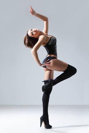 modern style dancer posing on studio background Stock Photo - 7718918