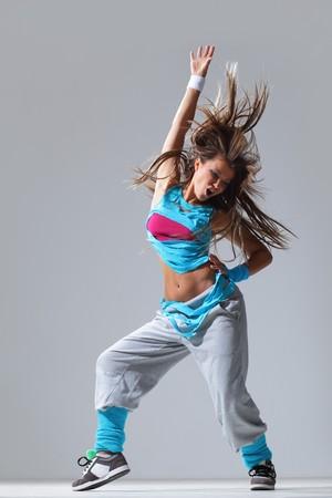 modern style dancer posing on studio background photo