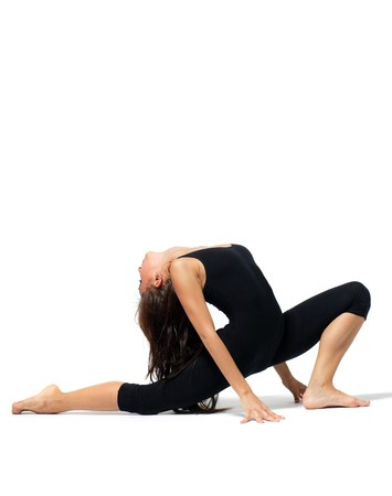 stunts: modern style dancer posing on studio background