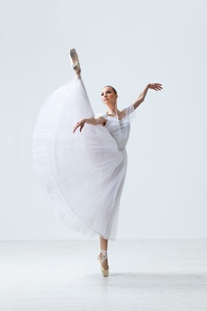 young and beautiful ballet dancer jumping  photo