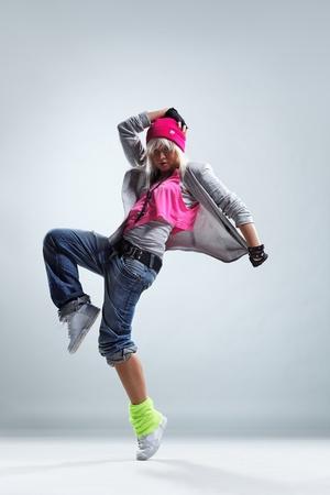 modern style dancer posing on studio background Stock Photo - 9105075