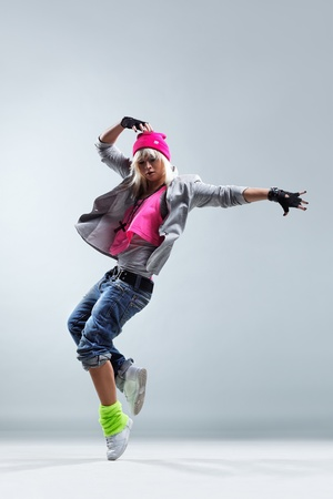dance: modern style dancer jumping on studio background Stock Photo