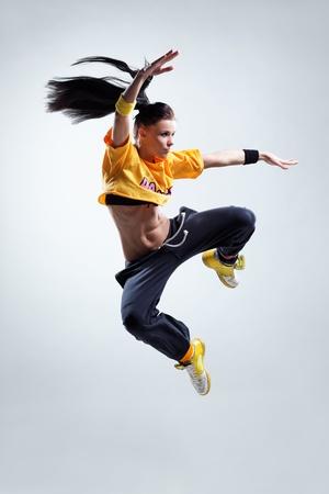 modern style dancer posing on studio background Stock Photo - 9104848