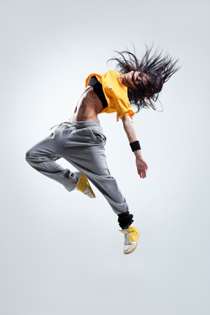 modern style dancer jumping on studio background 스톡 콘텐츠