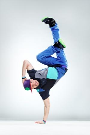 stunt: modern style dancer posing on studio background