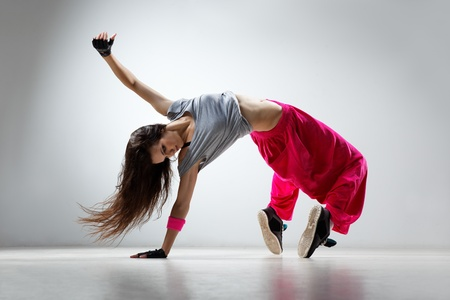 breakdancing: young and beautiful dancer posing in studio