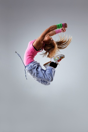 young and beautiful dancer posing on studio background Stock Photo - 12085055