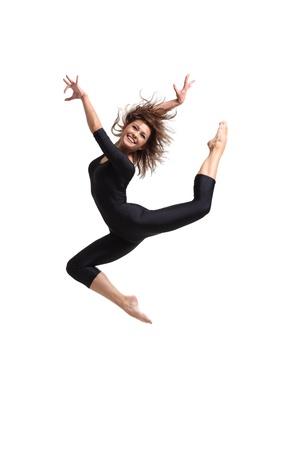 young and beautiful dancer posing in studio photo