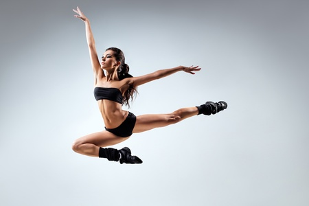 young and beautiful dancer posing in studio photo