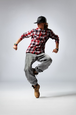 hip-hop dancer posing on studio background photo