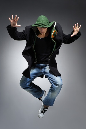 breakdance: modern style dancer posing on studio background