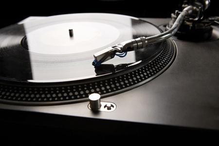 music studio: Vinyl disk player in backlight
