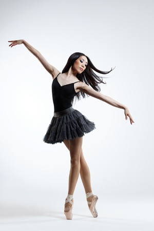 young beautiful dancer posing on a studio background Stock Photo - 14199039
