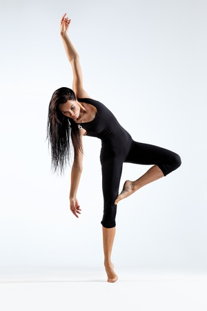 dancers: young beautiful dancer posing on a studio background