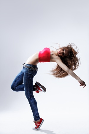 tiptoe: young beautiful dancer posing on a studio background