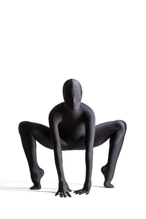 Silhouette of a human in black zentai suit photo
