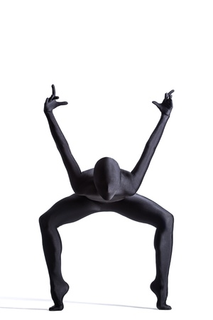 Silhouette of a human in black zentai suit
