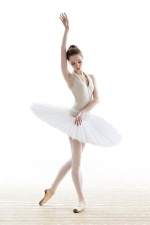 silhouette of ballerina in classical tutu in the white studio Reklamní fotografie - 17535444