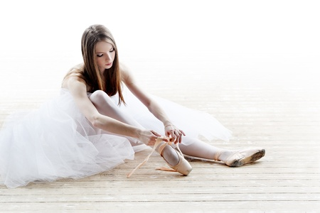 ballet slipper: silhouette of ballerina in classical tutu in the white studio Stock Photo