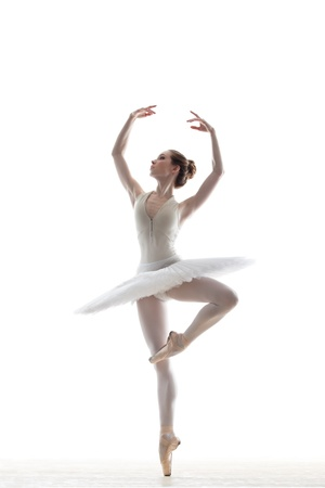 silhouette of ballerina in classical tutu in the white studio  photo