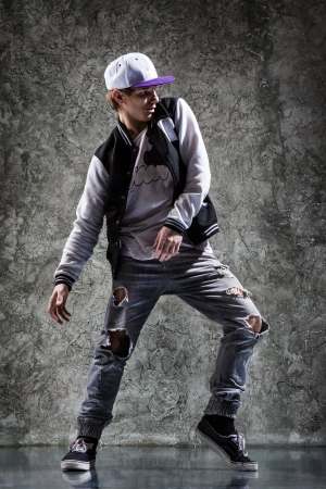 cool looking and stylishly dressed dancer posing photo