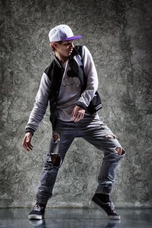stylishly: cool looking and stylishly dressed dancer posing