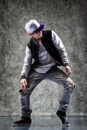 raps: young beautiful dancer posing on a studio background