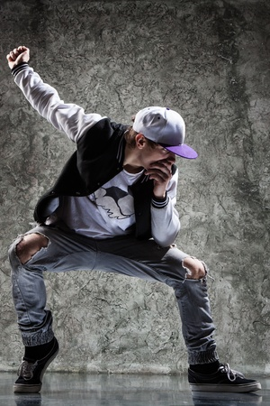 dancing pose: cool looking and stylishly dressed dancer posing
