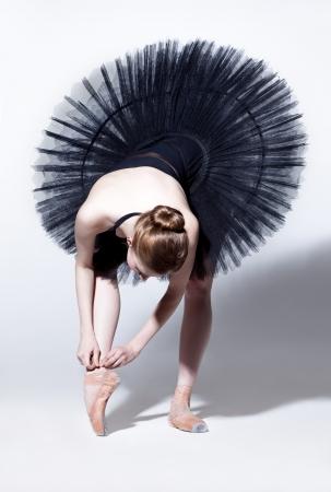 young beautiful dancer posing on a studio background Reklamní fotografie - 19614940