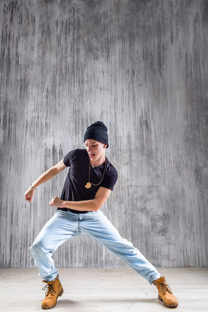a dancer posing on a studio background Stock Photo