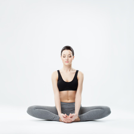 young beautiful yoga posing  on a studio background Stok Fotoğraf - 23050296