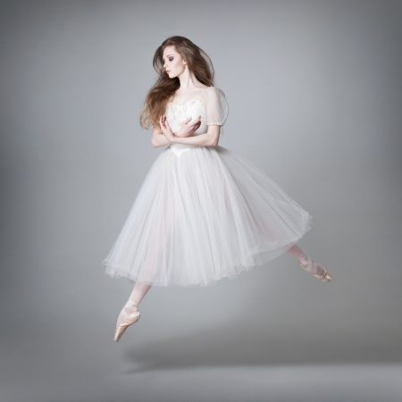 young beautiful dancer posing on a studio background Reklamní fotografie - 23050335