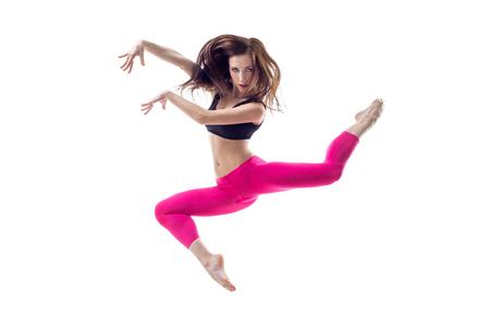 ballet dancing: young beautiful dancer posing on studio