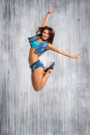 young beautiful dancer posing on studio background photo