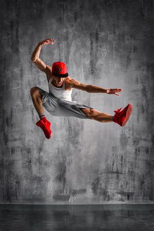 young beautiful dancer posing on studio background Stok Fotoğraf - 28001126