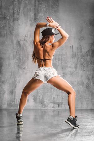 booty: young beautiful booty dancer posing on studio background Stock Photo