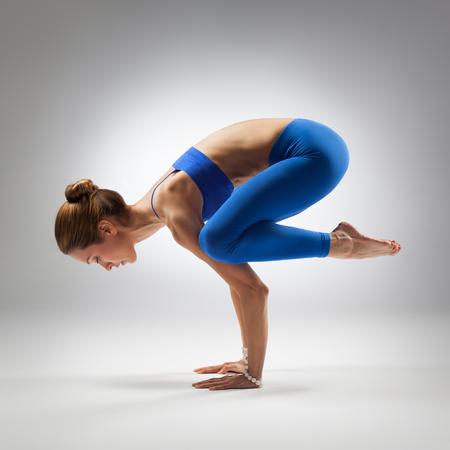 young beautiful yoga posing on a studio background Stock Photo