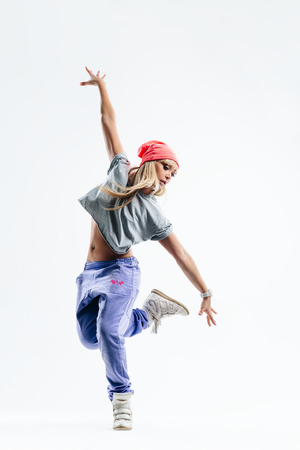 dancers: young beautiful dancer jumping on a studio background Stock Photo