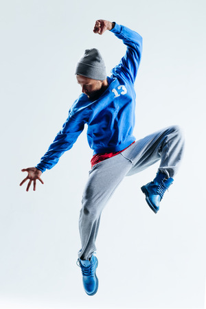 male dancer: young beautiful dancer posing in studio