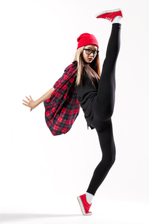 fashionable female: young hip-hop dancer posing in studio