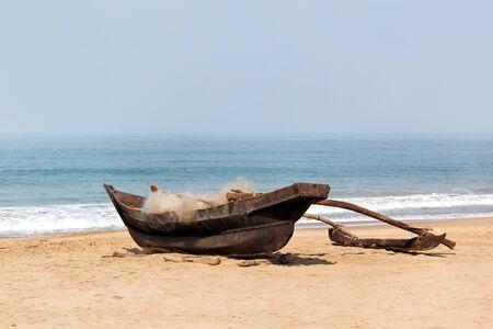 fishermans net: Fishermans boat on the indian seashore