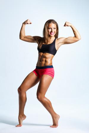 voluptuous women: beautiful fitness female posing on studio background